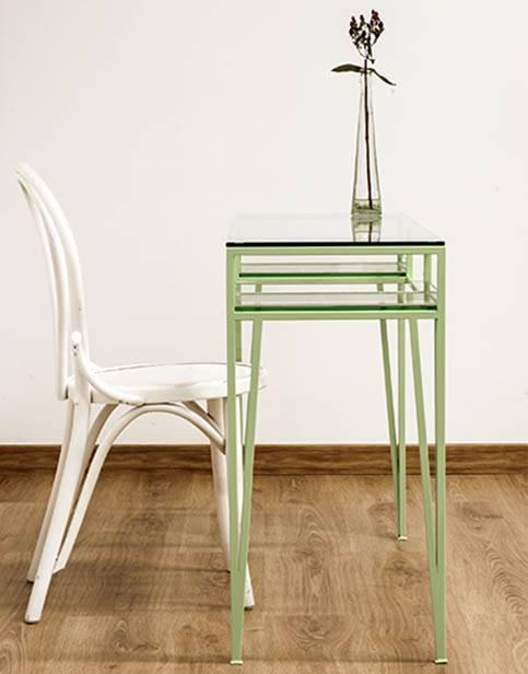 Tlocador verde de acero y cristal